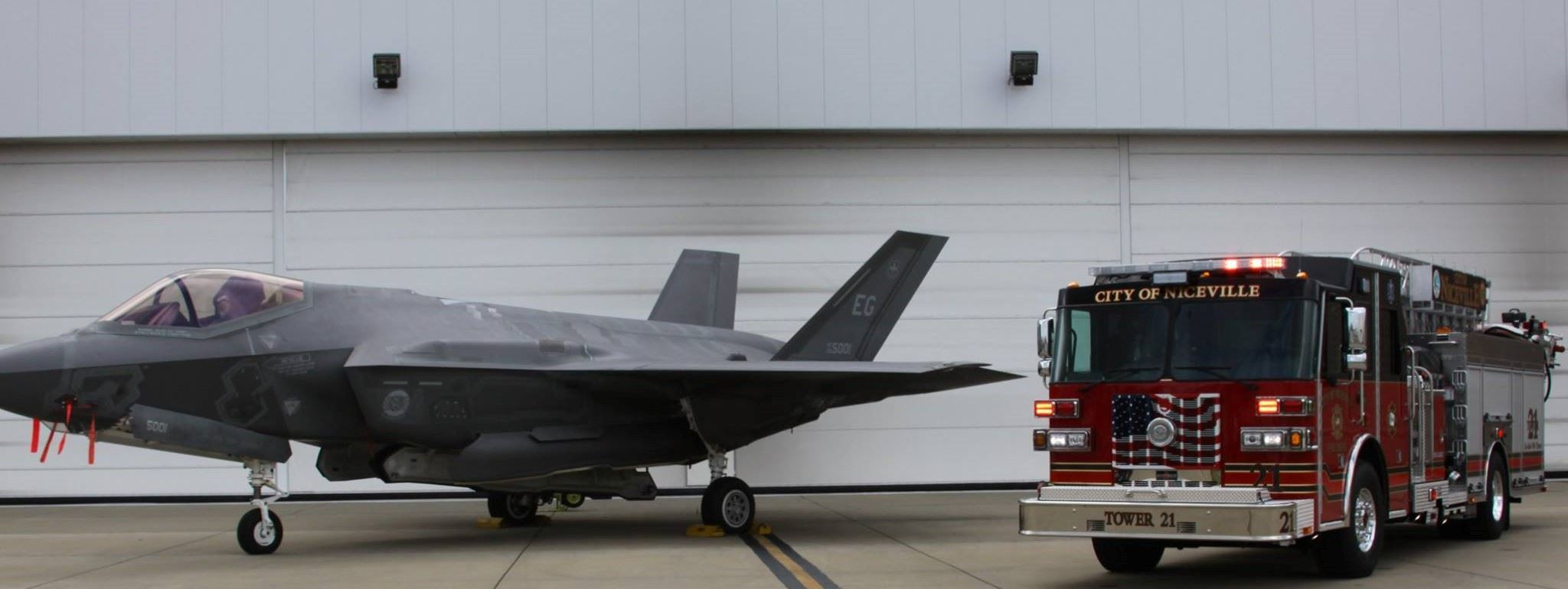 F35 fighter jet next to Tower 21