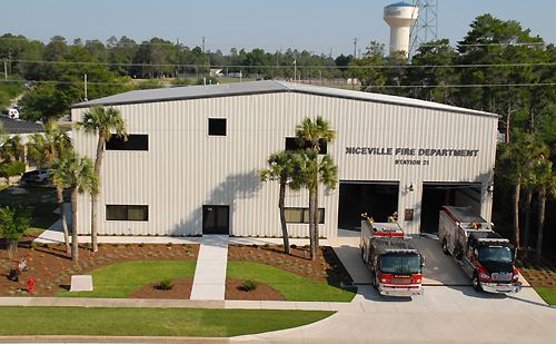Aerial image of new fire station with two engines in bays